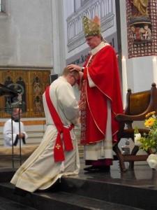 Priesterwijding handoplegging